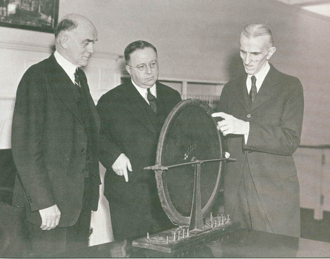 Nikola Tesla explaining the rotating magnetic field to representatives of Westinghouse Electric & Man. Co. on May 10, 1938.
